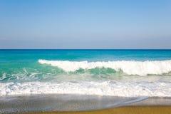 Waves and sandy beach. Stock Photos