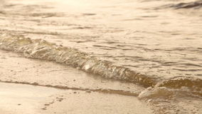 Waves on a sandy beach stock video footage