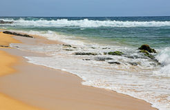 Waves on Sandy Beach Stock Photography