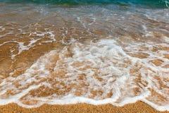 Waves on a sandy beach Stock Photography