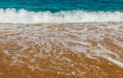 Waves on a sandy beach Royalty Free Stock Images