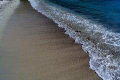 Beach waves in St. Thomas, U.S. Virgin Islands. Waves on sandy beach in St. Thomas U.S. Virgin Islands royalty free stock photo