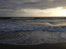 Waves at Santa Monica beach. Waves lapping on the sand at Santa Monica beach Royalty Free Stock Image