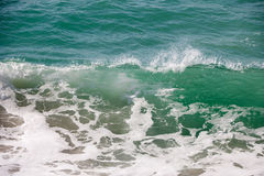 Waves in sea. Closeup of cresting waves in sea Royalty Free Stock Photos