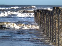 Waves and sea barriers at Blyth beach Royalty Free Stock Photography