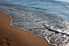 The waves of the sea beach Royalty Free Stock Photo
