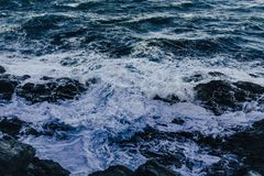 Waves of the sea crashing against the rocks. royalty free stock photos