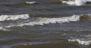 Waves of the sea in the daytime in summer.  stock footage