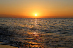 Waves of the sea, illuminated by sunlight at sunset. Costa del Sol (Coast of the Sun), Malaga in Andalusia, Spain Royalty Free Stock Photography