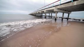 Waves, sea and pier. Stock Photography