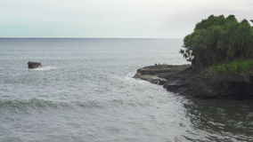 Waves of the sea roll on the stony coast, Bali, Indonesia stock video footage