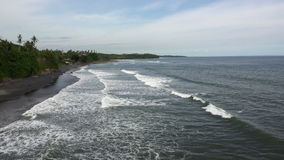Waves of the sea roll on the stony coast, Bali, Indonesia stock video