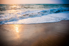 Waves of the sea on the sand beach Royalty Free Stock Photo