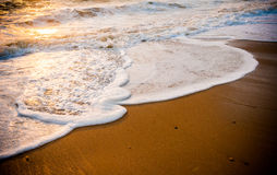Waves of the sea on the sand beach Royalty Free Stock Image