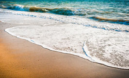 Waves of the sea on the sand beach royalty free stock photography