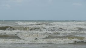 Waves on the sea during a storm in a slow motion. A strong wind blows from the sea. The storm wind is rising. Slow-motion shooting stock footage