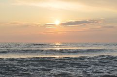 Waves in the sea with sunset in summer stock image