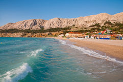 Waves on sea and touristic beach at Baska - Krk Croatia stock photography