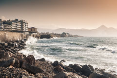 Waves on the seafront at sunset. Heraklion, Crete island, Greece Royalty Free Stock Image