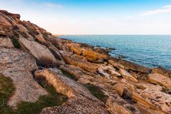 Waves on seashore. Seashore, big rocks Royalty Free Stock Images