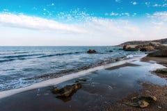 Waves on seashore. Seashore, rocks and surf Stock Photo