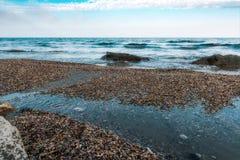 Pebble beach. Seashore, rocks and surf Stock Photography