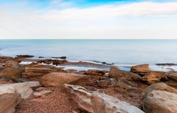 Waves on seashore. Seashore, rocks and surf Stock Image