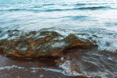 Waves on seashore. Seashore, rocks and surf on beach Stock Images