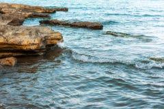 Waves on seashore. Seashore, rocks and surf on beach Stock Photography
