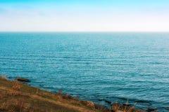 Waves on seashore. Seashore, rocks and surf on beach royalty free stock photos