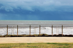 Waves Seen Through Stainless Steel Fence