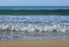 Waves on Selmun Bay (Imġiebaħ Bay). Mediterranean Sea on Selmun Bay - Malta, sand, waves and sun Royalty Free Stock Photo