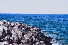 Waves sharpen stones royalty free stock photo
