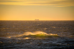 Waves and a ship. Waves in stormy weather towards the horizon stock photos