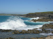 Waves at shore. Waves crash into the shore of the west coast of Ireland on Doolin, County Clare stock photos