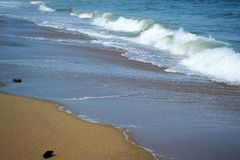 Waves at shore. Beautiful landscape of crushing waves on the sand beach in Greece Stock Photos