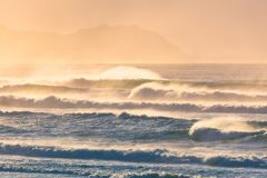 Waves on shoreline with beautiful sunset light. Waves on shoreline with a beautiful sunset light royalty free stock photography