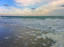 Waves, sky and foam Royalty Free Stock Images