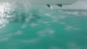 Waves slam the catamaran hulls as we move through heavy seas as seen from emergency escape window