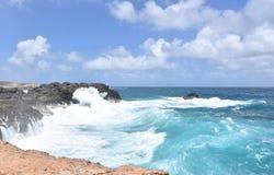 Waves Slamming Against the Rocks Near Andicuri Beach. Waves smashing against the rocks on Andicuri Beach in Aruba Stock Photo