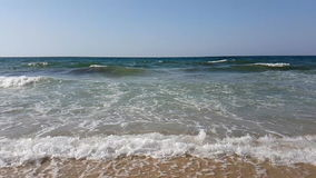 Waves in slow motion on the beach of the Mediterranean Sea in Tunisia.  stock video footage