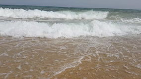 Waves in slow motion on the beach of the Mediterranean Sea in Tunisia.  stock footage