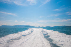 Waves from a speedboat during travel on island Royalty Free Stock Photo