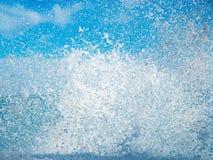 Waves splash. Against the blue sky Stock Images