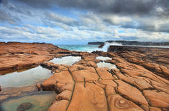 Waves splash on magnificent rock formations Stock Photography
