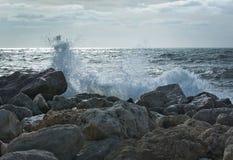 Waves splash onto rocks. On a windy day in December in Mallorca, Balearic islands, Spain Stock Photo