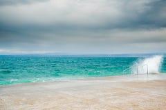 Waves splash pier Stock Photography