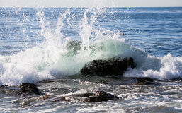 Waves Splashing against rocks Royalty Free Stock Photo