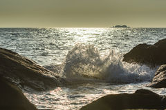 Waves splashing against rocks Stock Images