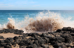 Waves splashing on basalt rocks at Ocean beach Bunbury  Western Australia Royalty Free Stock Photo
